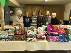 The women of the church meet to wrap presents that were purchased by donations from church members.  These gifts go to  children in the community.